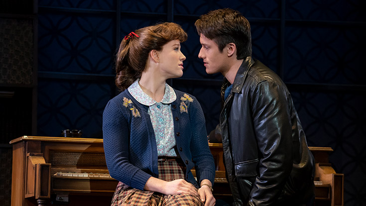 Kennedy Caughell as Carole King and James D. Gish as Gerry Goffin staring into each other's eyes at the piano
