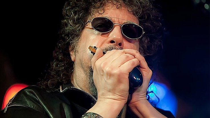 Magic Dick of the J. Geils Band playing harmonica.