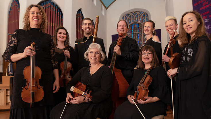 Members of Sacramento Baroque Solists post with their instruments.